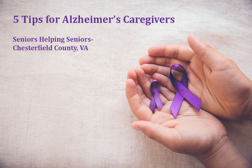 5 Tips for Alzheimer's Caregivers - hand holding purple ribbons
